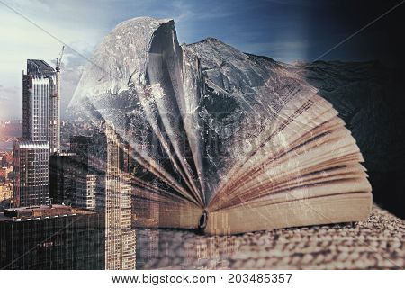 Abstract book on creative city background. Education concept. Double exposure