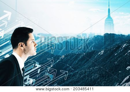 Side view of handsome young businessman on creative city landscape background with drawn upward arrows. Boss socncept. Double exposure