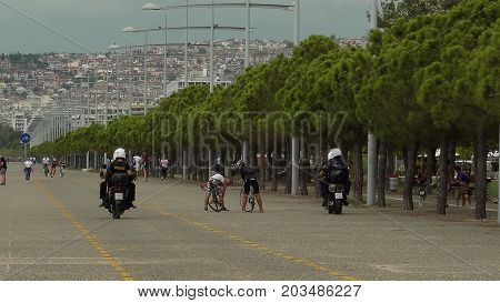 Greek Police Officers On Motorcycles Patrolling.