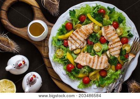 Salad With Tomatoes Sweet Pepper Chicken Fillet And Lemon Dressing