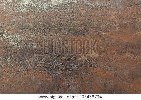 Old rusty sheet. Metal rusty texture.The process of aging of metal.