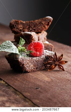 Homemade Chocolate Brownies With Raspberries And Mint On Wooden