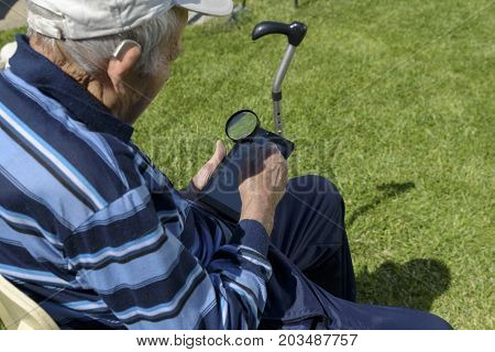 Old Man Tablet Magnifying glass Reading Hearing Aid