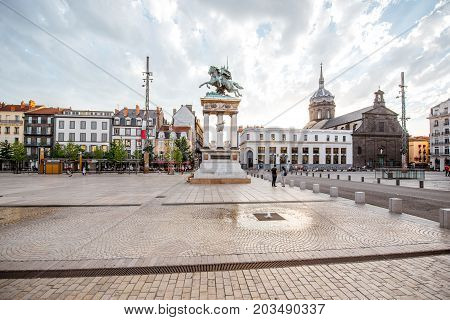 CLERMONT-FERRAND, FRANCE - July 31, 2017: View on the crowded Jaude square with statue and Saint-Pierre cathedral in Clermont-Ferrand city in central France