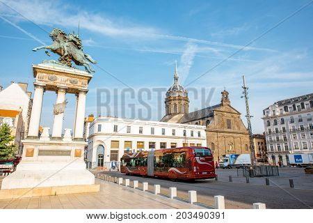 CLERMONT-FERRAND, FRANCE - August 01, 2017: View on the Jaude square with statue and Saint-Pierre cathedral in Clermont-Ferrand city during the morning light in central France