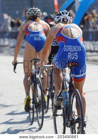 STOCKHOLM - AUG 26 2017: Rear view of russian female triathlete cyclists Gorbunova and Abrosinova the Women's ITU World Triathlon series event August 26 2017 in Stockholm Sweden