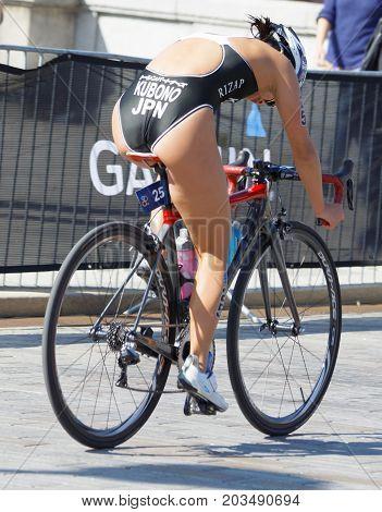 STOCKHOLM - AUG 26 2017: Rear view of female triathlete cyclist Minami Kubono (JPN) in the Women's ITU World Triathlon series event August 26 2017 in Stockholm Sweden