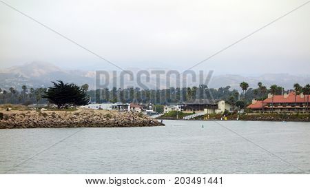 VENTURA CA USA - JULY 4 2013: People enjoying a relaxing fishing time near Ventura harbor durig 4th of July holiday city of San Buenaventura Southern California
