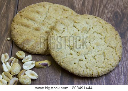 Fresh Peanut Butter Cookies On Wooden Boards With Peanuts