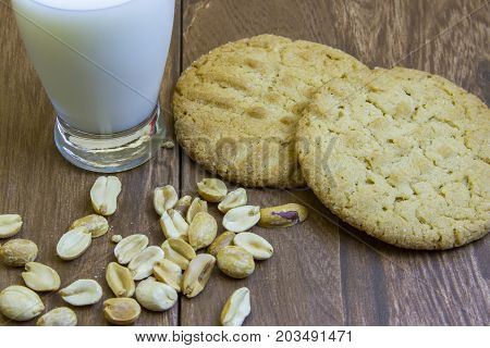 Fresh Peanut Butter Cookies On Wooden Boards With Milk