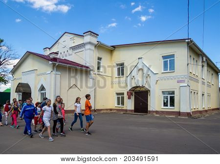 Ramon Russia - June 07 2017: Children walk past the regional center of culture and leisure Ramon settlement of the Voronezh region