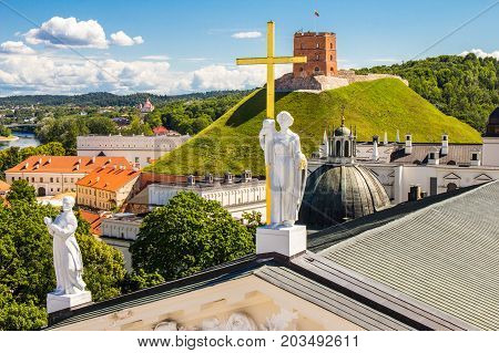 Scenic summer view of the Old Town architecture with Gediminas Tower From The Bell Tower of Cathedral Basilica Of St. Stanislaus And St. Vladislav in Vilnius, Lithuania