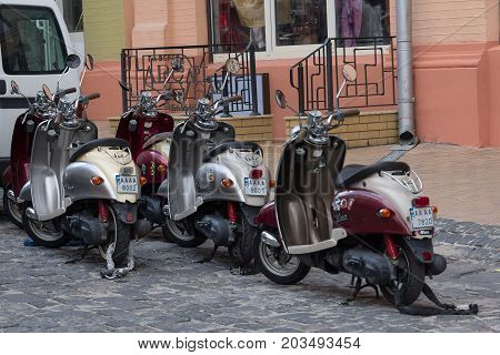 Kiev Ukraine - July 02 2017: Many motor scooters parked in the street Andreevsky Descent