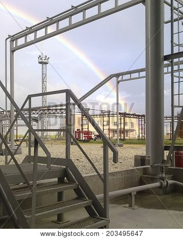Rainbow on the background of an industrial facility