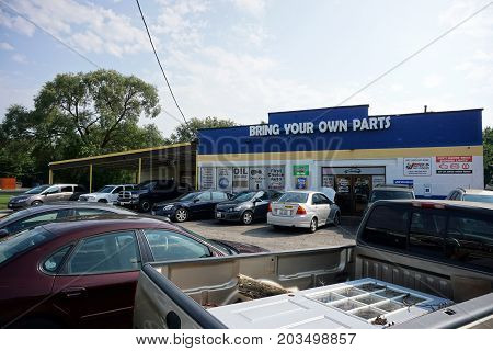 CREST HILL, ILLINOIS / UNITED STATES - JULY 20, 2017: Motorists may bring their own automobile parts to First Choice Auto Repair, on Plainfield Road.