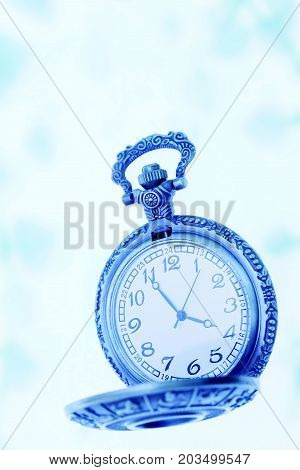old pocket watch on blue cyaan background