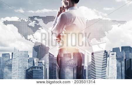 Double exposure of elegant businessman with hand on chin looking away