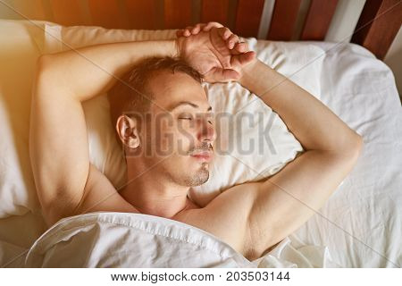 One young men sleeping in bed above view