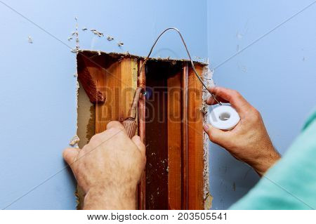 Plumber Working With Water Installation