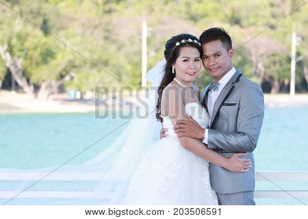 Asian couples in outdoor Pre Wedding PhotographyLocations seaside in Thailand seaconcept of love and the beginning of family life.