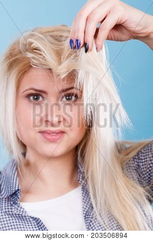 Blonde Woman Holding Her Hair Ends
