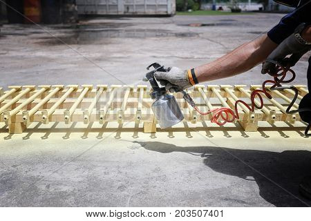 Workers spraying automotive parts in Concept of work manufacturing industry.
