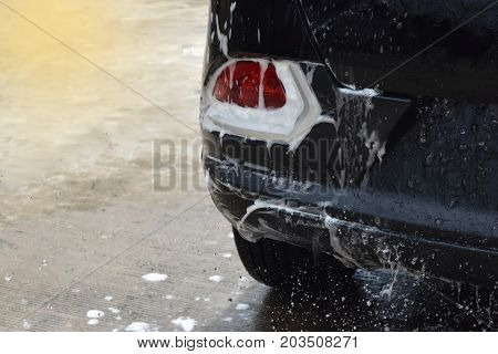 wash the tail lights car black Bubbles filled the area and empty space for text.