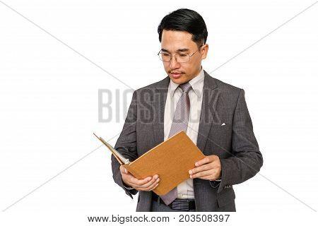 Businessman holding file folder on a white background.