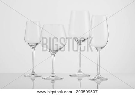 several empty wine glasses on a white background