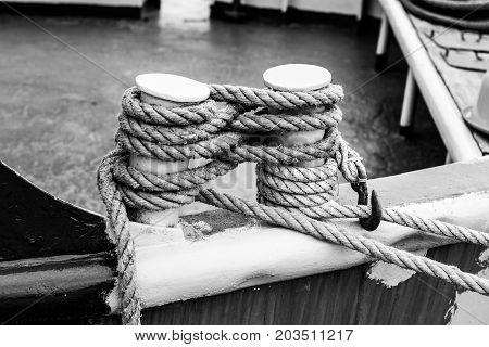 Cleat On The Stern Of A Boat With A White Rope.