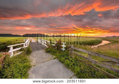 Bridge At Sunrise Over Lowland River Grootdiep