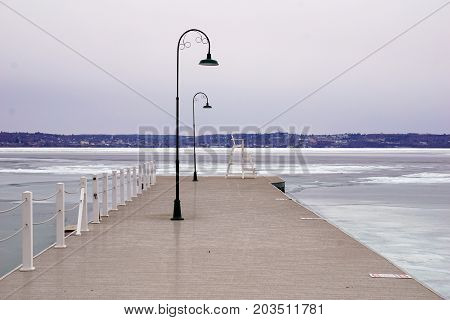 The dock in Wequetonsing, Michigan, during March, when ice still covers Little Traverse Bay.