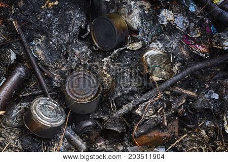 rubbish burned in wet weather close up