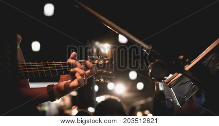 Guitarist on stage. Guitarist playing guitar soft and blur concept.