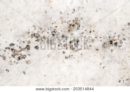 background of stone rubble in the snow