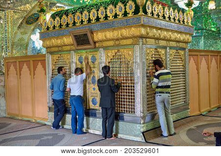 Fars Province Shiraz Iran - 18 april 2017: Muslims pray in Mosque Mirrored mausoleum of Sayyed Alaeddin Hossein.