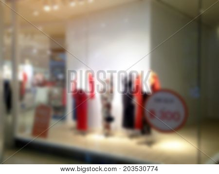 blurred image of showcases fashion clothes display in department store shopping mall shopping lifestyle concept