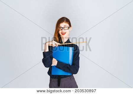 Joyful business woman in glasses with bright lipstick, holds in her hand a ruler and a blue folder with documents.