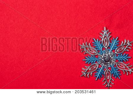 Christmas background with Christmas toys as background. snowflakes on a red background