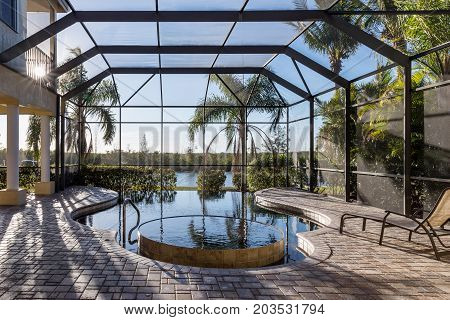 Pool with Jacuzzi at Florida House. Typical Florida house with swimming pool. Florida. USA