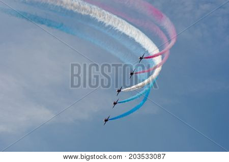 Clacton Essex United Kingdom -25 August 2017: Red arrows display team flying in formation over Clacton in annual free air display