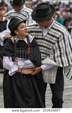 June 17 2017 Pujili Ecuador: indigenous man and woman dancing in traditional costumes at Corpus Christi parade