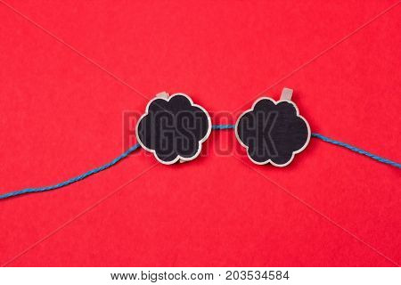 Clothespins with a place for writing on a red background