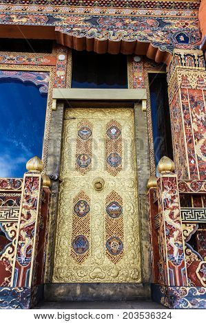 Traditional Bhutanese temple architecture in Bhutan South Asia. View of the beautiful ornate door of the temple.