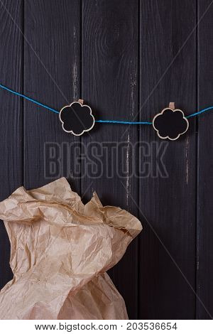 A craft bag near a black fence with a clothes peg and a place for text