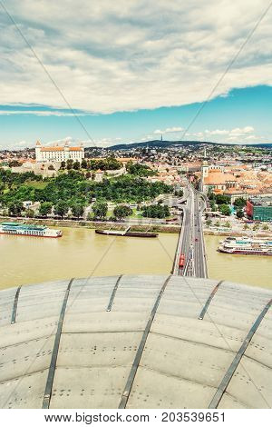 Bratislava is the capital city of Slovak republic. Beautiful castle Saint Martin's cathedral bridge SNP Danube river and Kamzik TV Tower. Architectural theme. Photo filter.