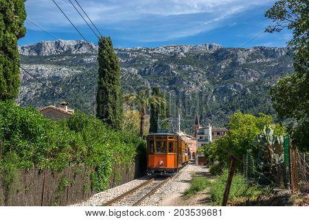 Vintage tram in Soller Majorca, Mallorca island, Balearic Islands, Spain. Mountains beautiful landscape