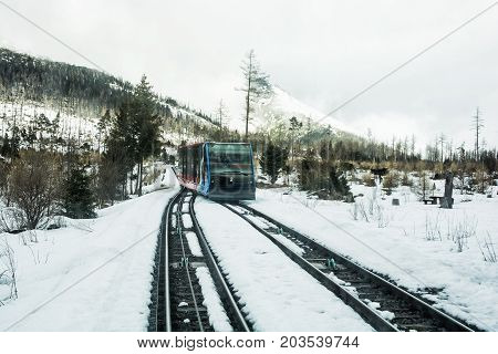 Funicular railway at High Tatras mountains in Slovak republic. Rail cable car leads from Stary Smokovec to ski and tourist resort Hrebienok.
