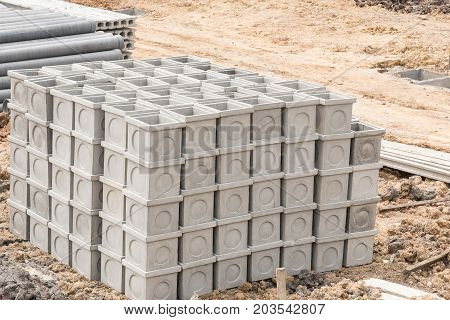 Concrete manholes for use in construction job.