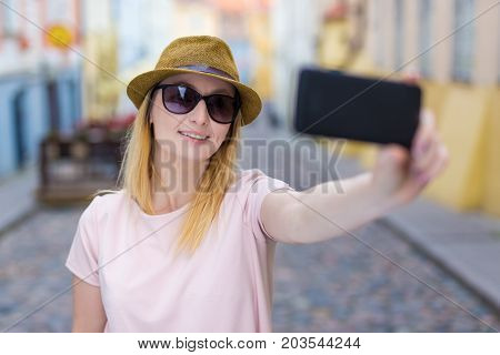 Young Woman Tourist Taking Selfie Photo With Smart Phone